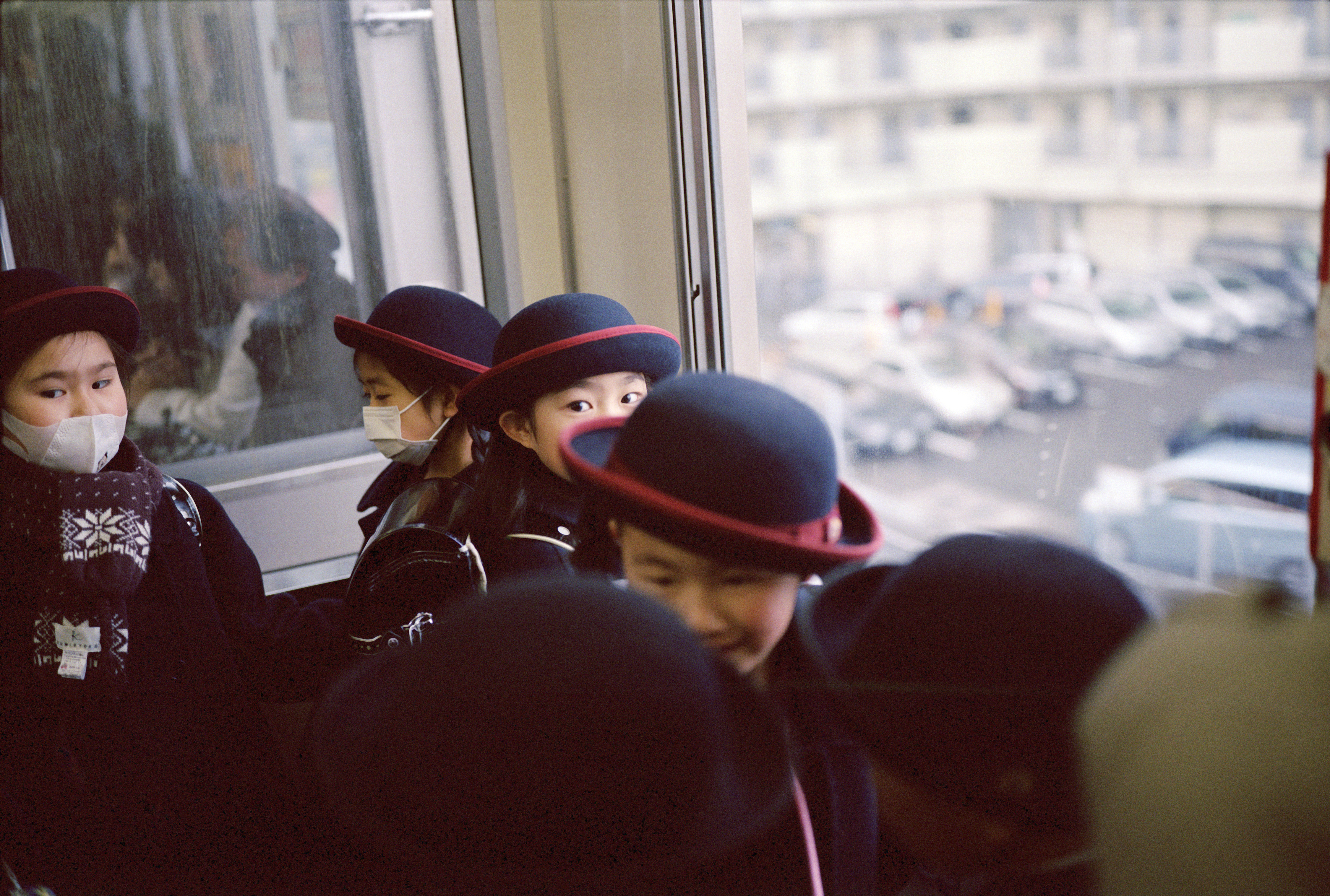 Children standing inside the metro and going to school